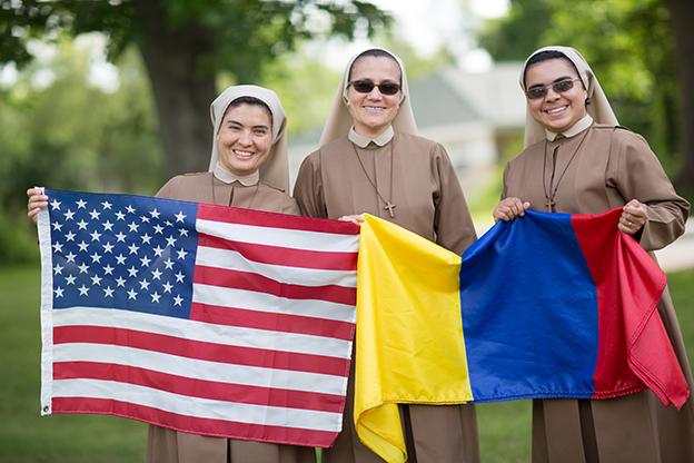 Catholic sisters holding flags