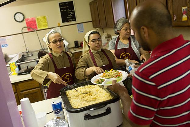 Catholic sisters serve a meal in Kalamazoo