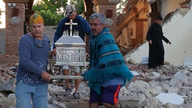 Men carry tabernacle at Immaculate Conception Parish after Puerto Rico Earthquake