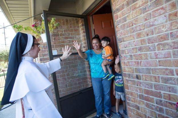 Sister Yelitza waves to a family