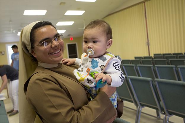 Catholic Sister Maryud with Baby