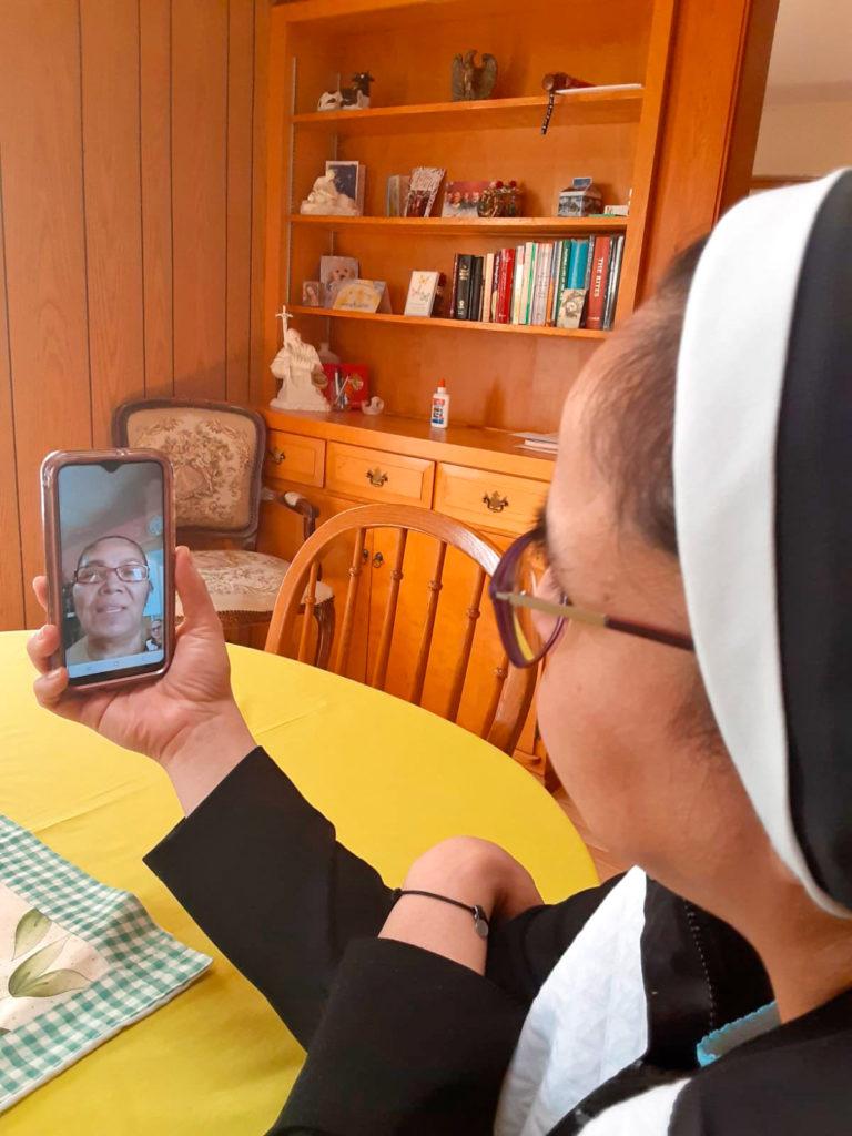 1918 Flu vs Coronavirus, Catholic Sister video chats on her phone