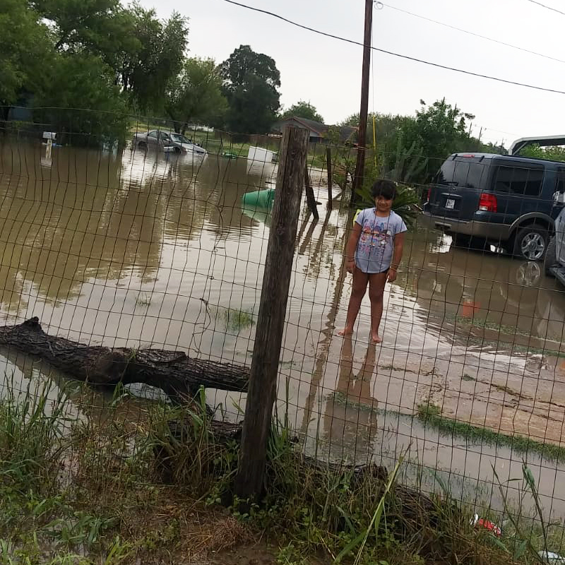 Young girl stands in flooding after Hurricane Hanna