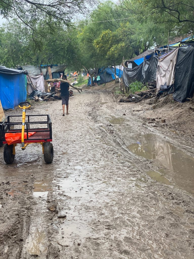 Immigrant tent city after Hurricane Hanna