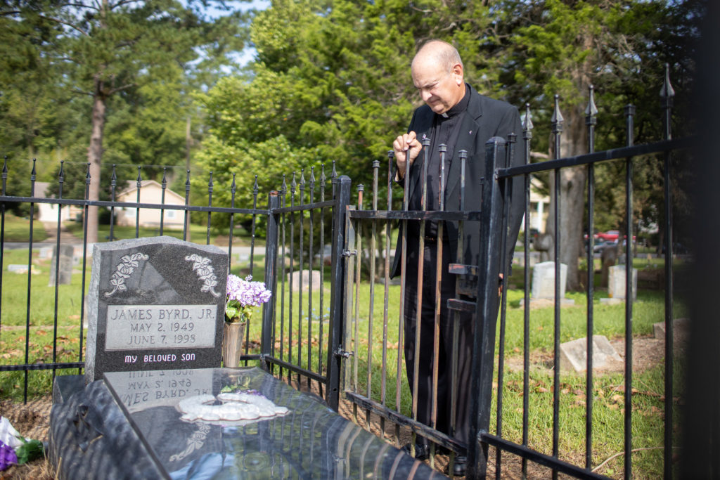 Father Ron Foshage at the grave of James Byrd, Jr.